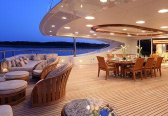 alfresco dining area on upper deck aft of motor yacht JAGUAR
