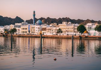 historic buildings lining the corniche in Muscat, Oman