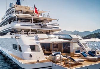 large beach club with sun loungers on board luxury yacht Cloud 9