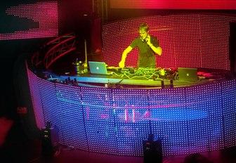 a DJ takes to the decks in an exclusive Ibiza club