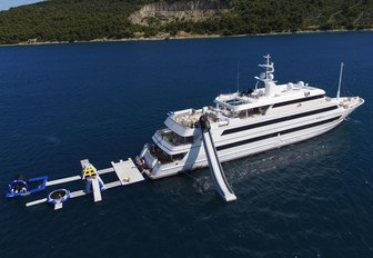 motor yacht KATINA anchors on charter alongside her water toys