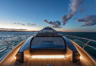 Sunpad on motor yacht BEYOND at sunset with lighting emanating from teak deck