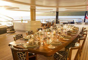 The alfresco dining table on board superyacht SOLANDGE
