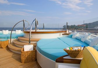 Step-up Jacuzzi surrounded by sunpads on the forward section of the sundeck aboard motor yacht OASIS