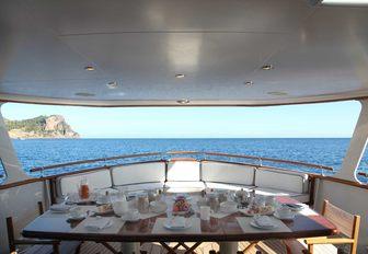 alfresco dining area on the main deck aft of luxury yacht 'Heavenly Daze'