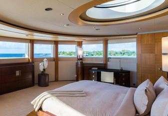 master suite with panoramic views and skylight on board motor yacht WHEELS