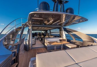 View inside motor yacht BEYOND, tables and chairs visible
