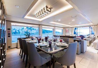 sophisticated dining area in main salon aboard luxury yacht ONEWORLD