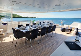 alfresco dining setup on the upper deck aft of luxury yacht Take 5