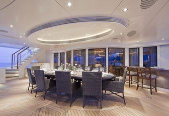alfresco dining on the main deck aft of luxury yacht HEMISPHERE