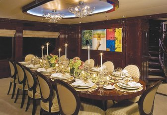 formal dining in main salon aboard charter yacht 'Lady Joy'