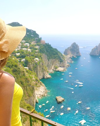 Woman looks out over sea in Capri