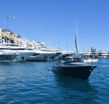 superyacht fleet in port hercules with tender in foreground