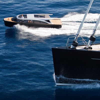 Vertigo Yacht Running Shot - Tender Alongisde