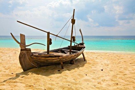 Boat on sandy coast