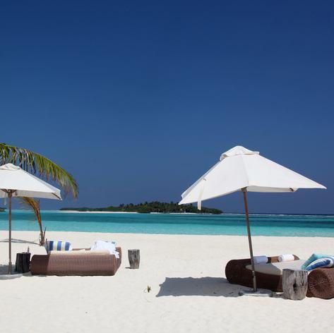 Sunbeds with umbrellas on the beach