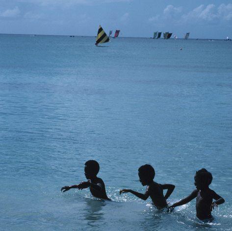 Three boys playing in the sea