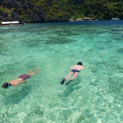 Men snorkelling in opposite directions
