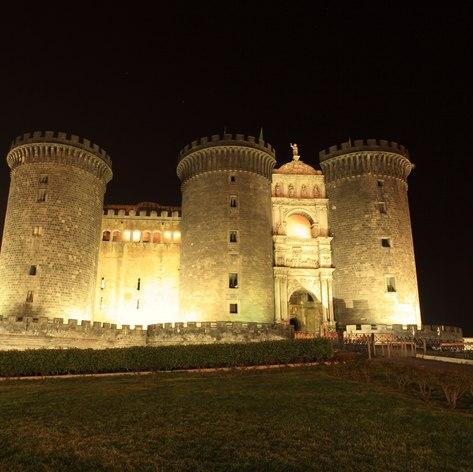 Night scene of Napoli Castel Nuovo and garden