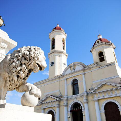 A lion statue outside a classic Cuban building