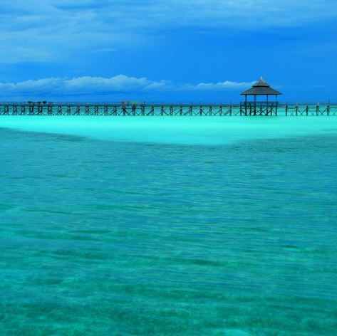 Long jetty on turquoise sea