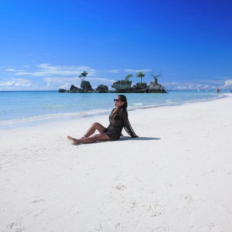 Sunbathing girl on the white beach