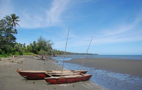 Sailing canoe at the sandy beach