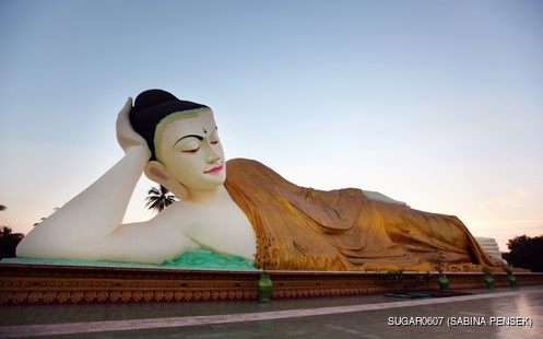 Reclining Buddha covered with a blanket statue