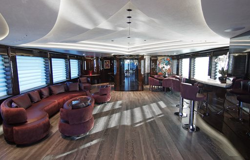 baba's yacht skylounge with red sofas