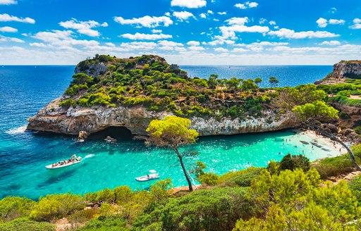 Mediterranean Sea beach at Majorca island, stunning seaside scenery of Cala Moro cove, Spain Balearic Islands.