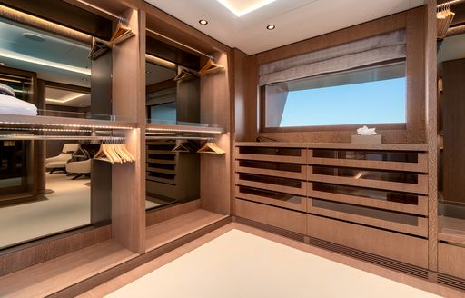 Walk in wardrobe on superyacht O'PARI