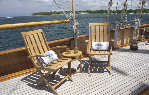 deck chairs and table with drinks on aboard luxury yacht EROS