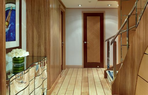 Wooden panelled corridor on Victoria Del Mar with staircase visible