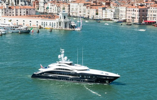 a motor yacht crusiing the coast of Venice while on a luxury yacht charter in Italy