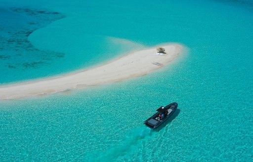 little tender and white sandbar in the maldives