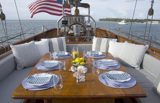 alfresco dining table on the deck of sailing yacht EROS