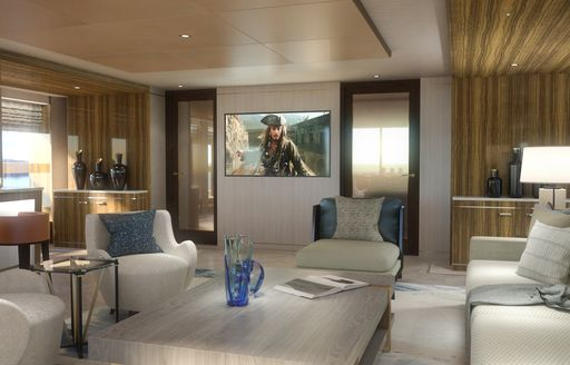 Armchairs around table of superyacht MOSKITO with large flatscreen TV in background
