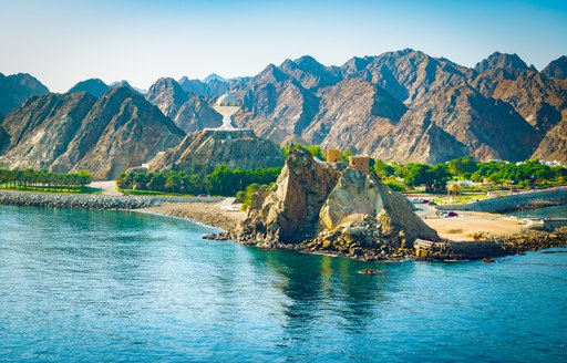 mountains by the water in oman, with rugged landscape