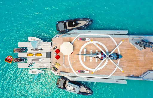 aerial view of luxury yacht bold, with helipad and toys