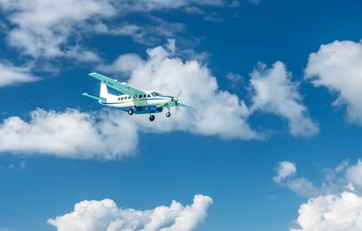little chartered plane flying in the sky above the caribbean