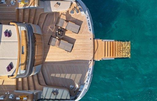 beach club and swim platform aerial shot on luxury yacht geco