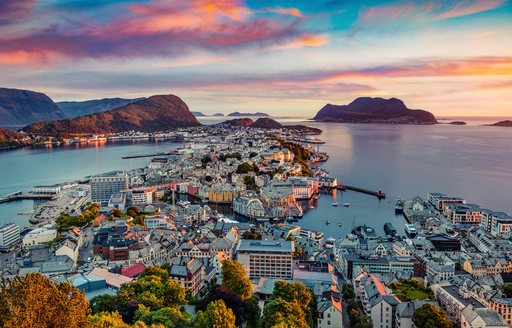 town of alesund with sunset in background