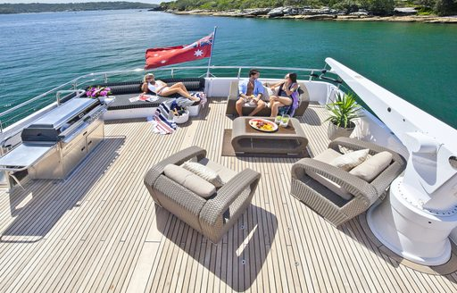 charter guests relax on the sundeck of motor yacht Quantum