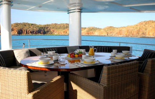 Alfresco dining table on the aft deck of superyacht Anda