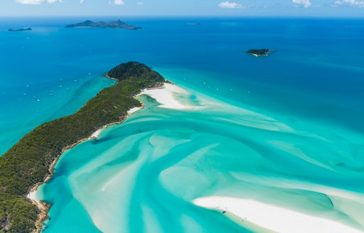 Aerial shot of the Whitsunday Islands, white sandy beaches and green blue sea