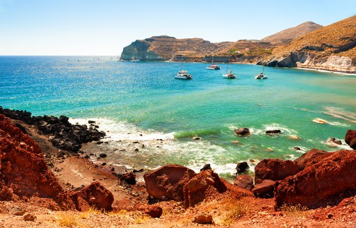 Waters at red sand beach greece