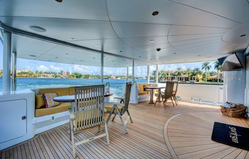 seating areas on the teak-clad main deck aft of luxury yacht STARSHIP