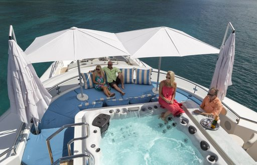 Charter guests sitting around jacuzzi spa pool in Belize