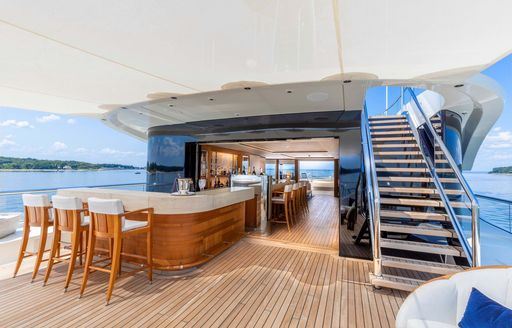 charter yacht sundeck with bar area and indoor-outdoor lounge space