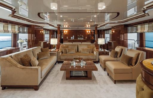 traditional styling in the main salon of motor yacht CHECKMATE